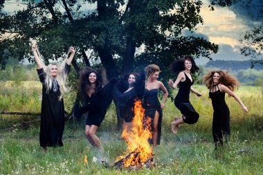 witches laughing around the campfire