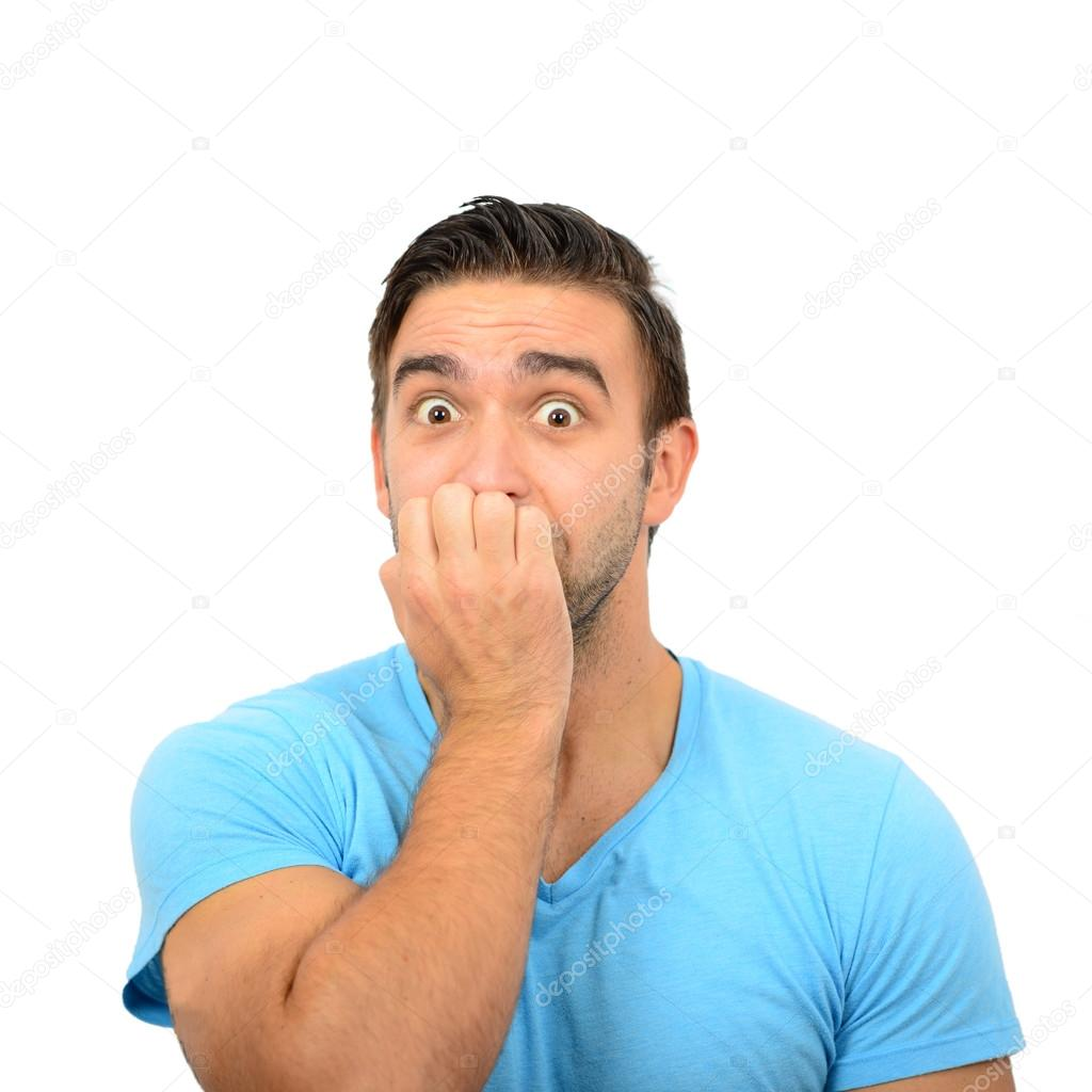 Portrait of man biting nails against white background — Stock Photo ...