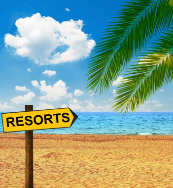 Tropical beach and direction board saying RESORTS