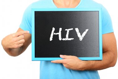 Man holding blackboard in hands and pointing the word HIV