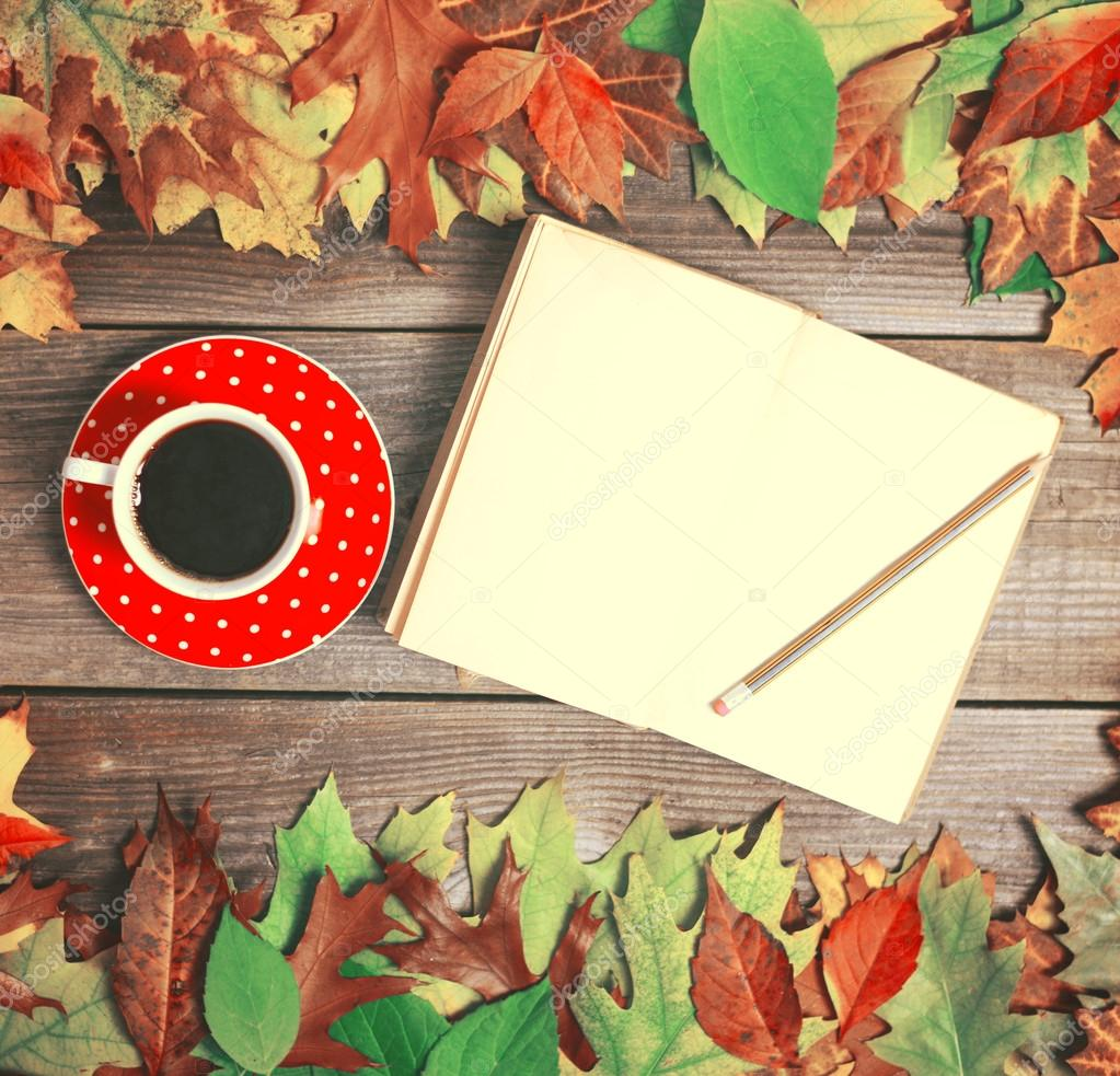 Colorful autumn background with autumnal leaves book and coffee