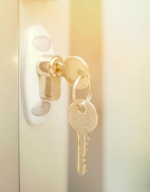 Door lock witj keys macro shot - Real estate concept
