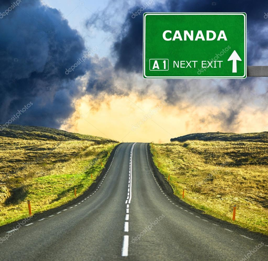 f4f59c5d90c67 CANADA road sign against clear blue sky — Stock Photo © Alexis84 ...