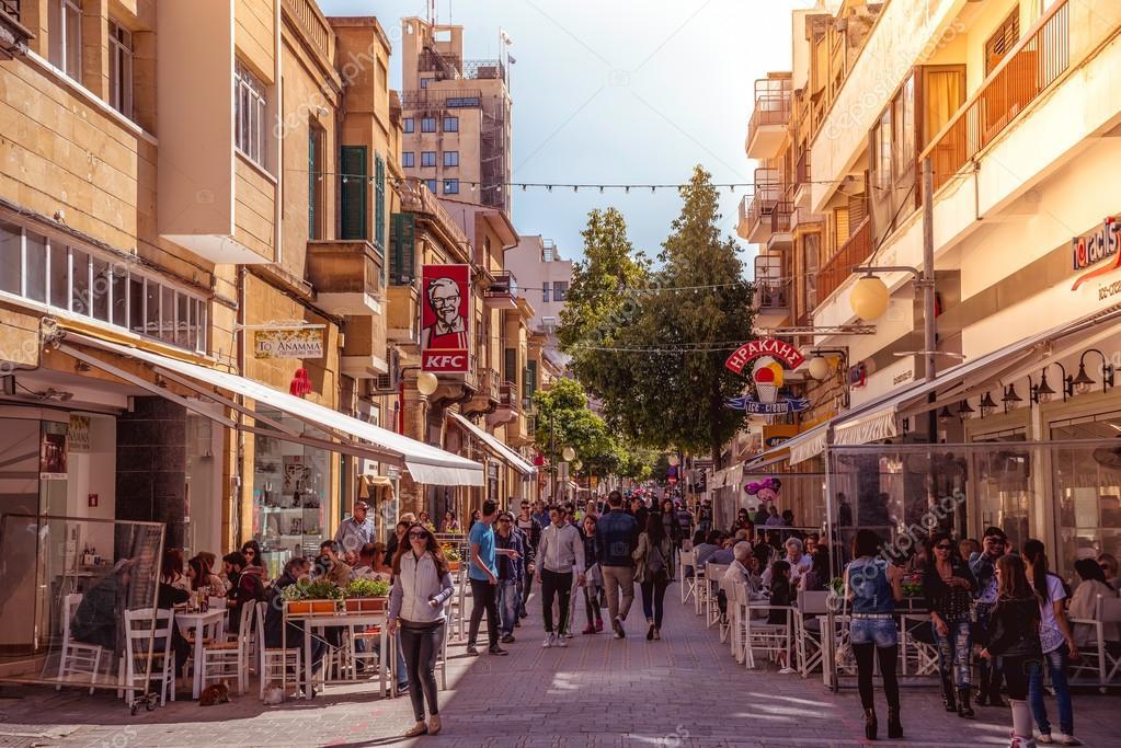 NICOSIA - APRIL 13 : People walking on Ledra street on April 13, 2015 in Nicosia, Cyprus. It is is a major shopping thoroughfare in central Nicosia