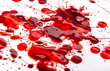Splattered blood stains on white background