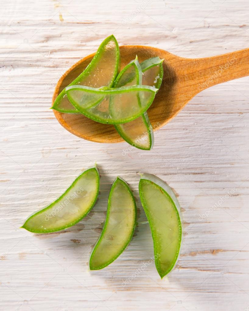 Aloe Vera leaves on wooden background