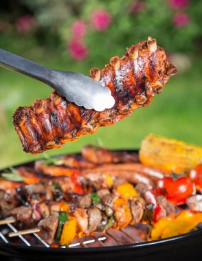 Delicious grilled meat with vegetable on a barbecue grill.