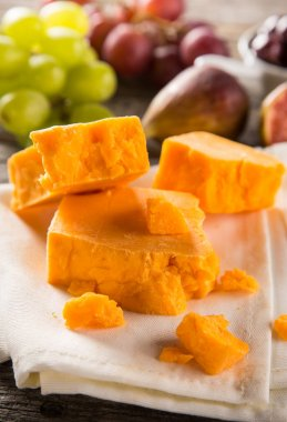 Delicious cheddar cheese on the table
