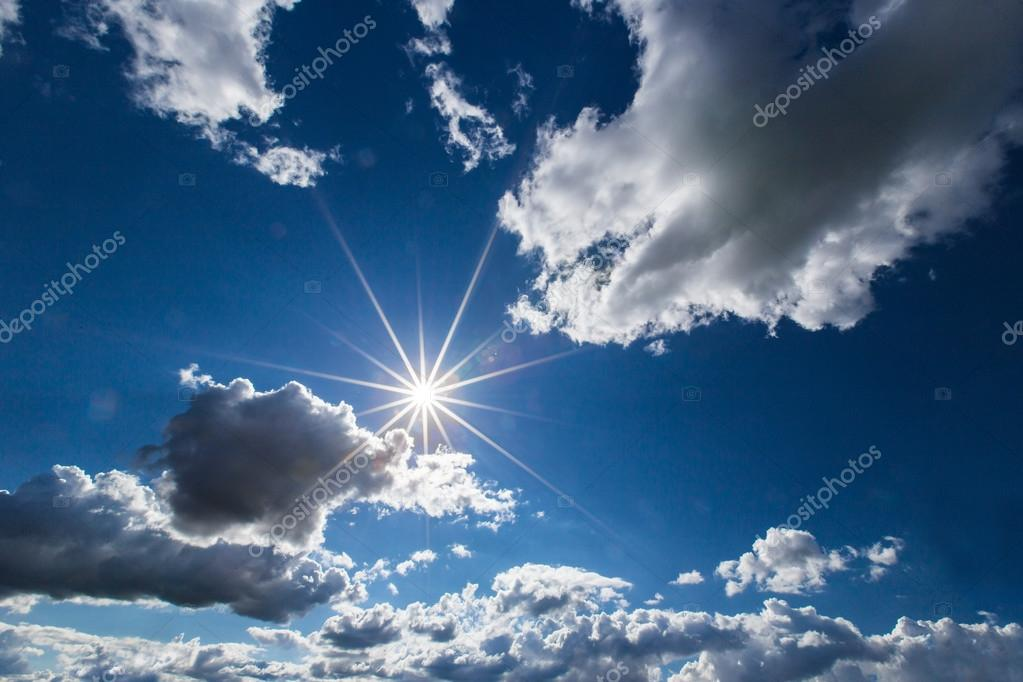 Dramatic blue sky with clouds and sun