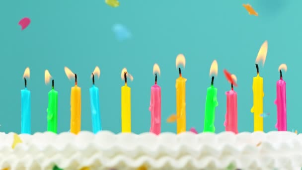 Birthday Cake With Burning Colorful Candles on Pastel Blue Background. Super Slow Motion.