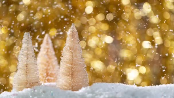 Christmas Still Life with Defocused Lights in Background and Snowflakes Falling. Super pomalý pohyb.
