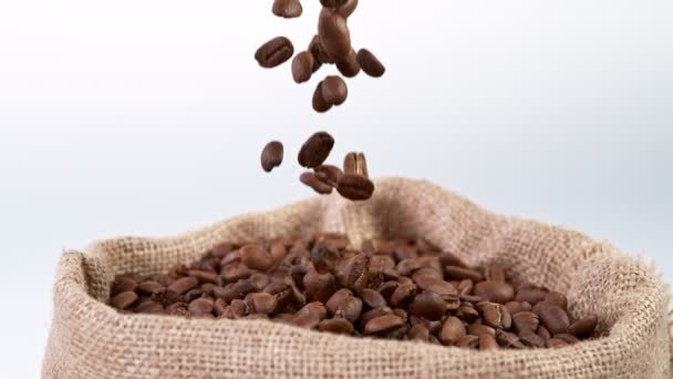 Super Slow Motion Shot of Falling Roasted Coffee Beans