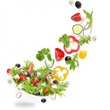 Fresh salad with flying vegetables ingredients