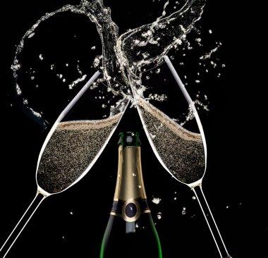 Champagne flutes on black background