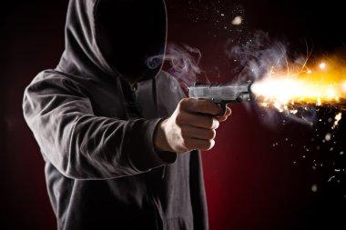 Killer with gun close-up on dark background stock vector