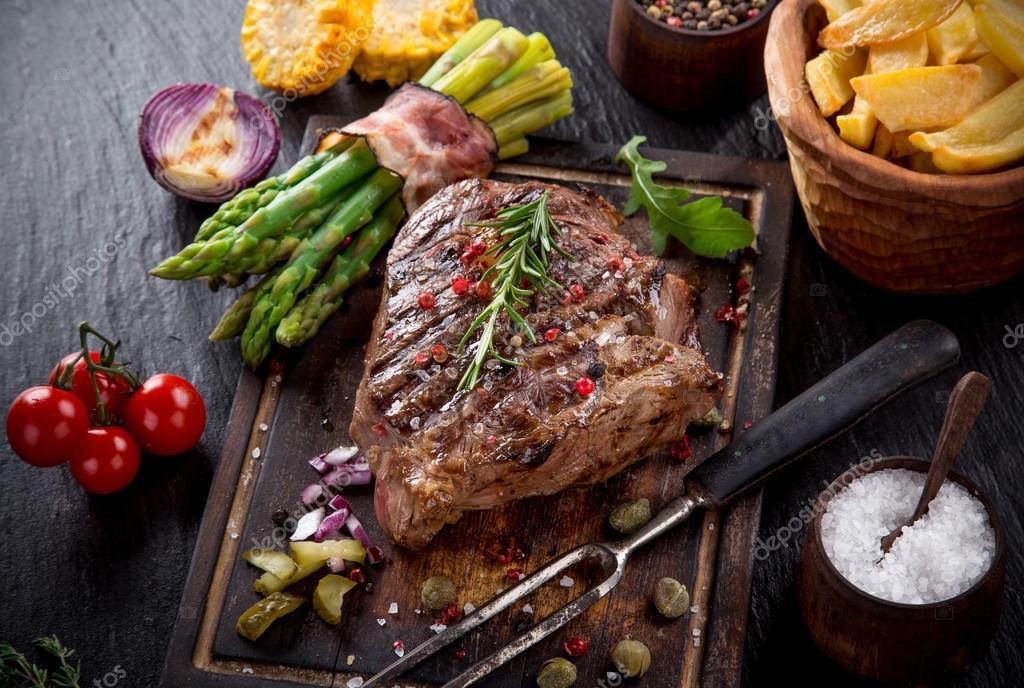 Beef steak on black stone table