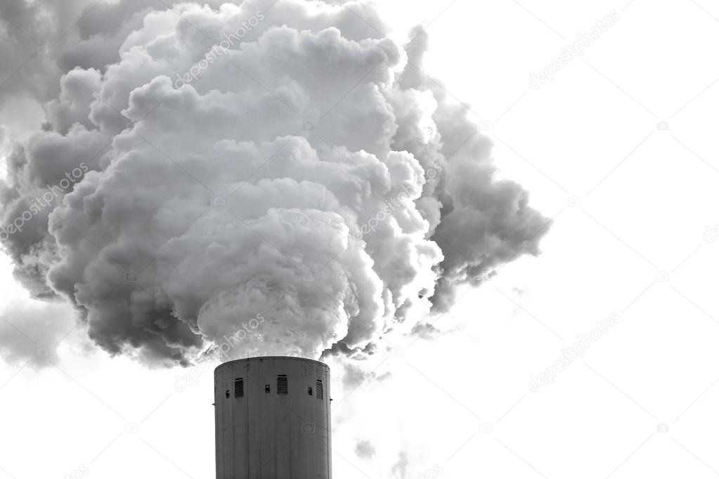 Smoke clouds from a high concrete chimney