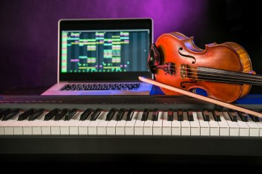 Piano with violin and notebook.