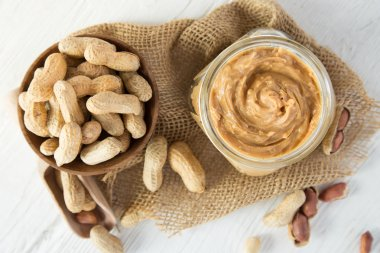 Peanut butter on wooden background.
