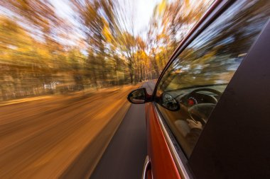 speeding car with motion blur background.