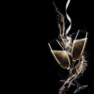 Glasses of champagne with splash