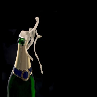 Bottle of champagne with wine explosion
