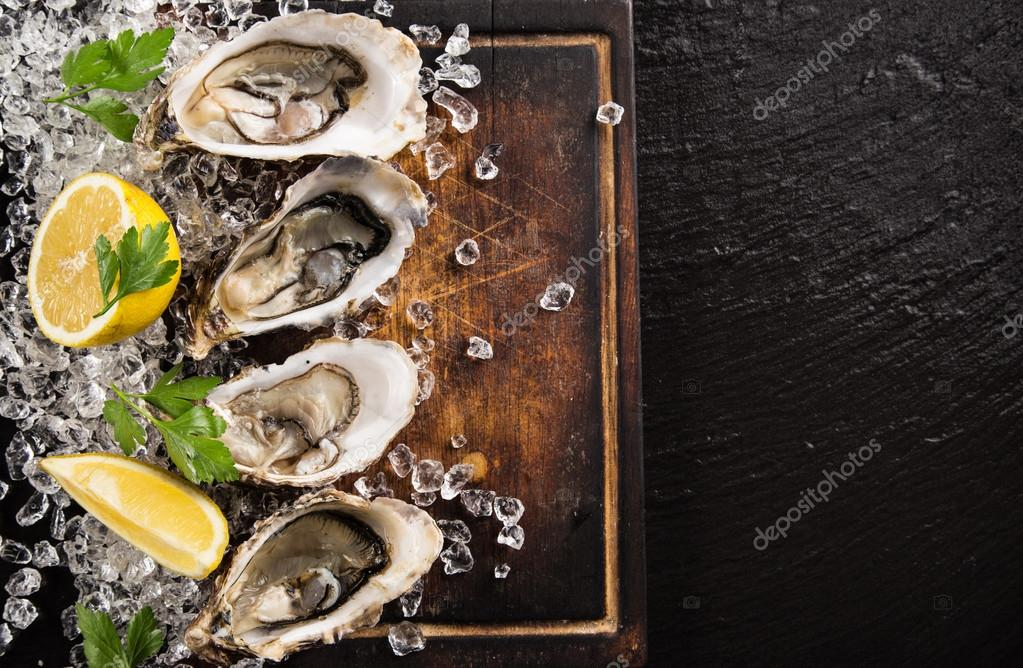 Fresh oysters on a black stone