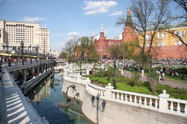 People walk in Alexander Garden of Moscow Kremlin