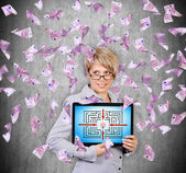 Fotografie woman holding digital tablet with success labyrinth  and flying euro banknote