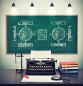 typewriter with paper and drawing business to business on  chalk board