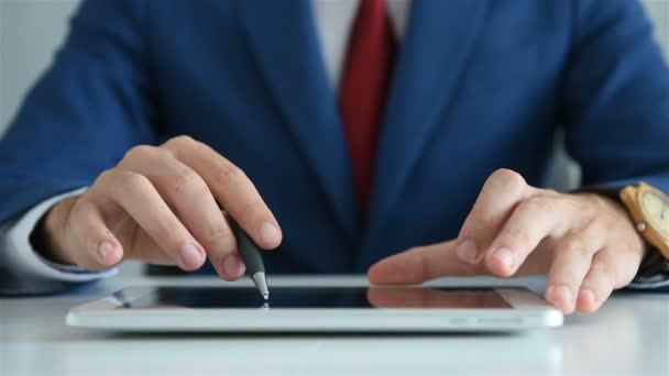 Close Up Of Businessman Working In Office And Using Digital Tablet With Annual Report. Business And Financial Success Concept. Slow Motion Effect.