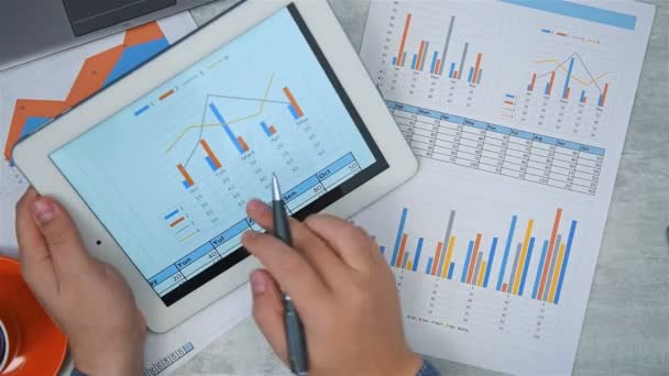 Broker Using Tablet Computer With Financial Report On Screen. Business And Financial Success Concept.