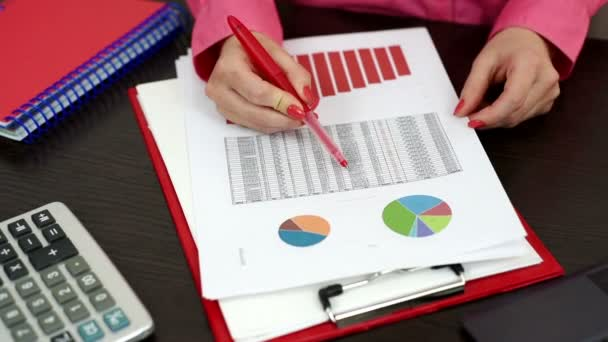 Woman considering financial report
