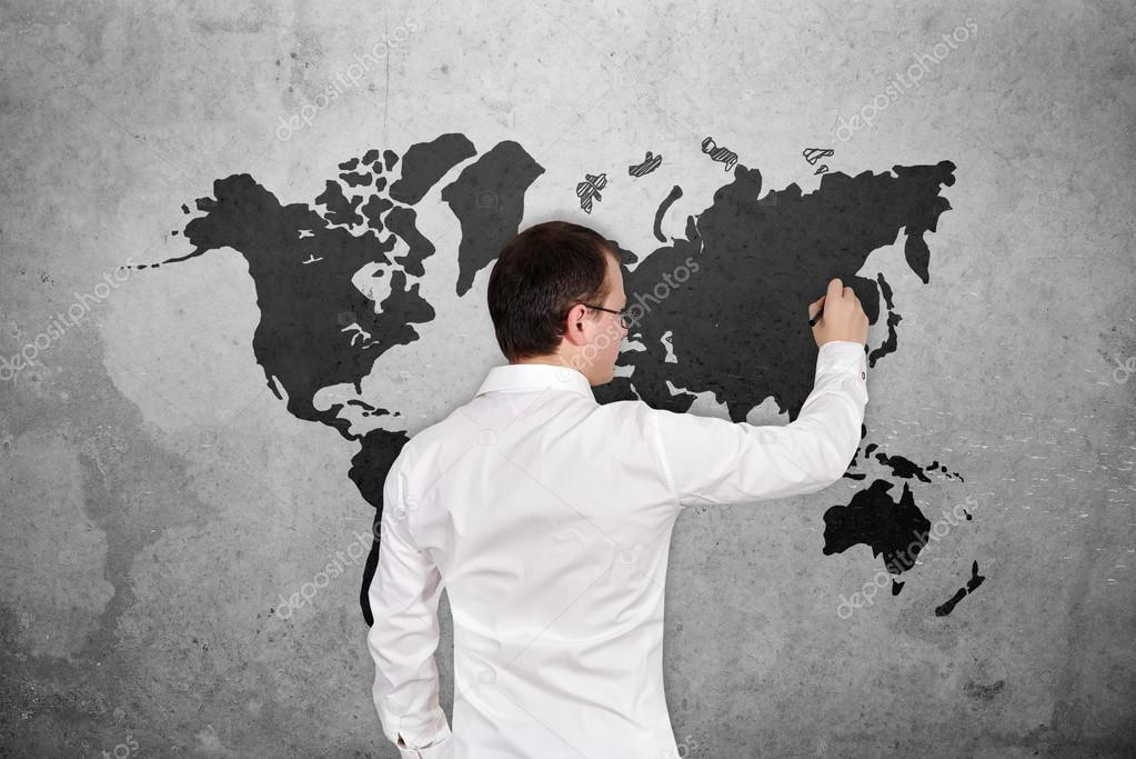 Man drawing world map stock photo vetkit 71868983 young businessman drawing world map on concrete wall photo by vetkit gumiabroncs Choice Image