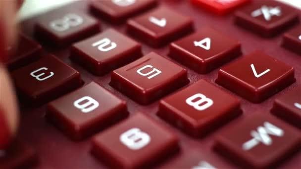 woman finger pushing calculator
