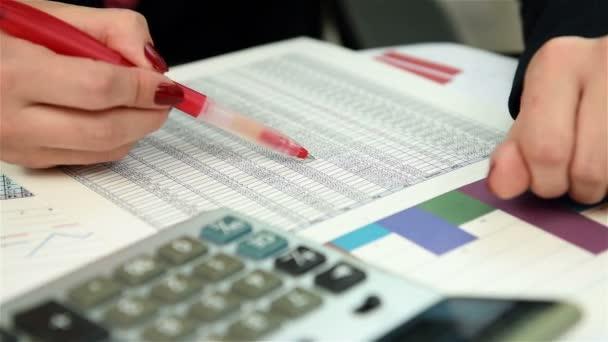 woman trader checking budget