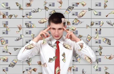 young businessman thinking and falling dollar bills.