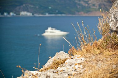 The Crimean landscape, the boat floats on the Black Sea