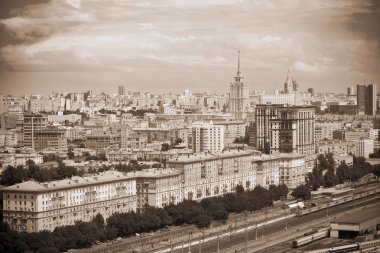 Moscow - city landscape, the historical part of the city, railroad in the foreground. Photo toned in sepia