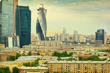 The Moscow city landscape. View of the historical Moscow and modern business center Moscow-City. Photo tinted in yellow