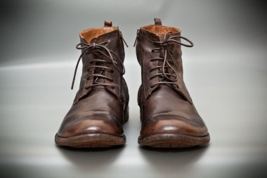 Expensive shoes autumn brown on gray abstract background. Autumn and spring leather shoes. Fashionable men's shoes