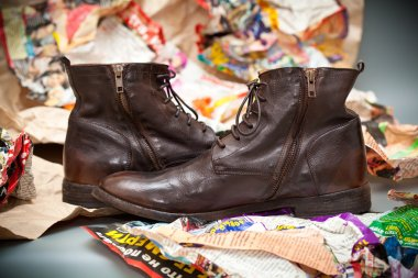 Expensive shoes autumn brown on the background of crumpled colored paper. Luxury leather men's shoes.