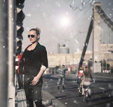 Brutal girl in the city on the bridge