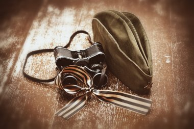 Soldier field cap, military binoculars, George Ribbon.
