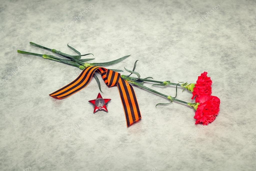 Two colors cloves, George Ribbon and the Order of the Red Star. Victory Day in the Great Patriotic War