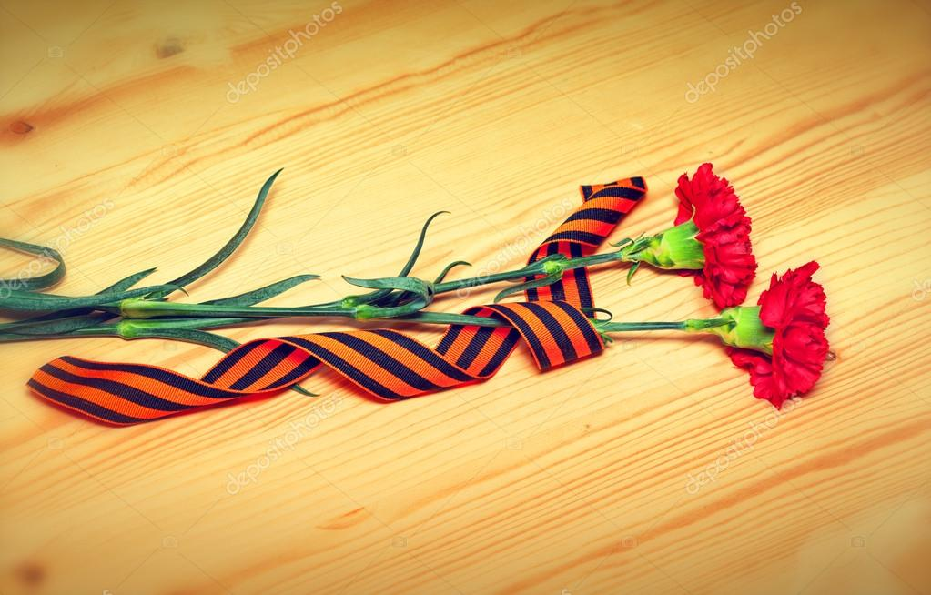 Carnation flowers and George Ribbon - a symbol of the Victory in the Great Patriotic War. Celebrate May 9 Victory