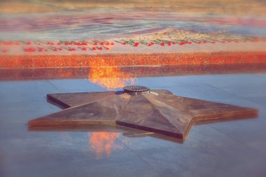 Eternal flame in memory of the Victory in the Great Patriotic War. vintage style. May 9 Victory Day