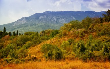 Beautiful Crimean landscape - mountains, trees, grass and sky