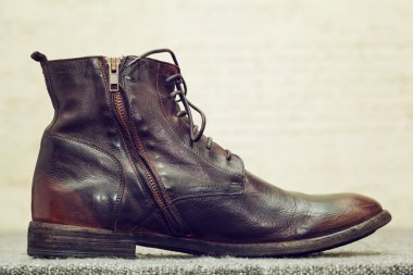 Fashionable leather high shoes brown with laces and zip fastener. Handmade shoes, stylized vintage style