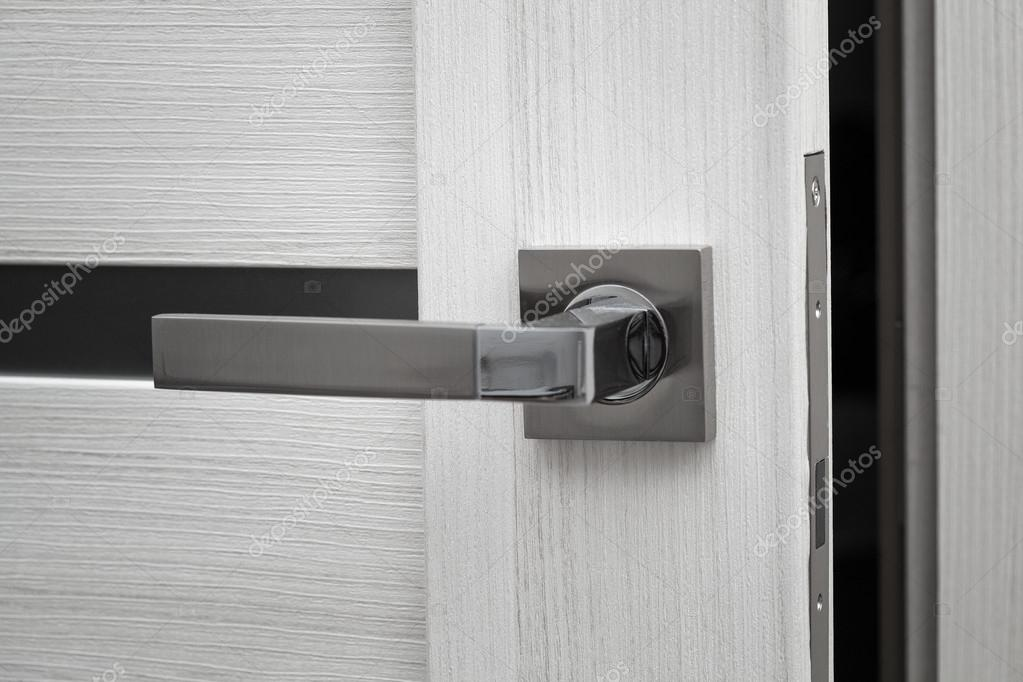 Door ajar and door handle close up u2014 Photo by Devin_Pavel & door ajar and door handle close up u2014 Stock Photo © Devin_Pavel #93655670